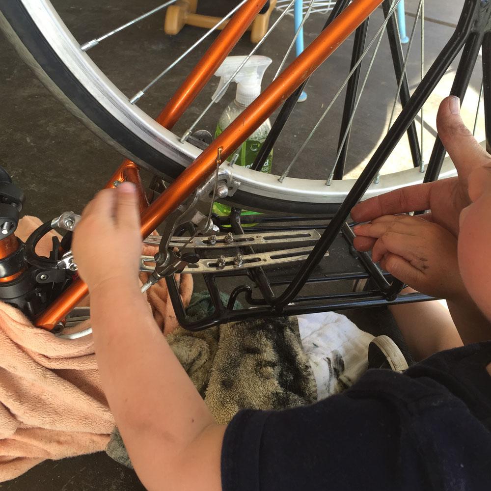 ride your bike mom and child making bike repairs